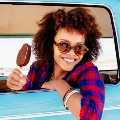 Brunette model with curly hair enjoying ice cream